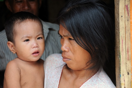 A young mother with her baby at the DGPC evacuation center in Datu Piang, Maguindanao, Philippines. Photo credit: IDMC/Frederik Kok
